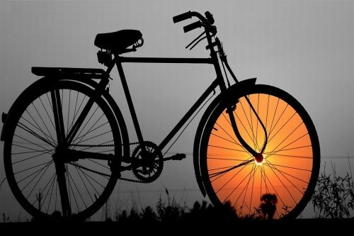 Glass Wall Art Bicycle at sunset, Glowing in the dark, 60 x 90 cm